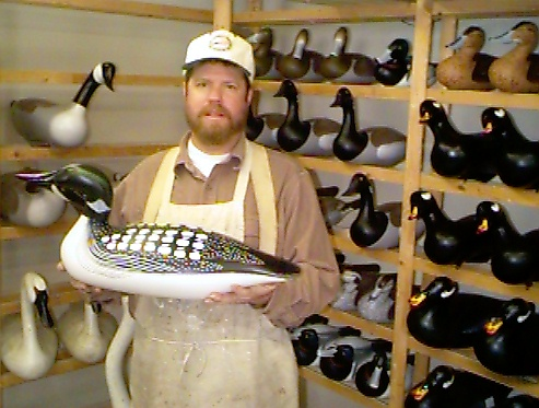Joey Jobes in his decoy shop with Full size Loon decoy