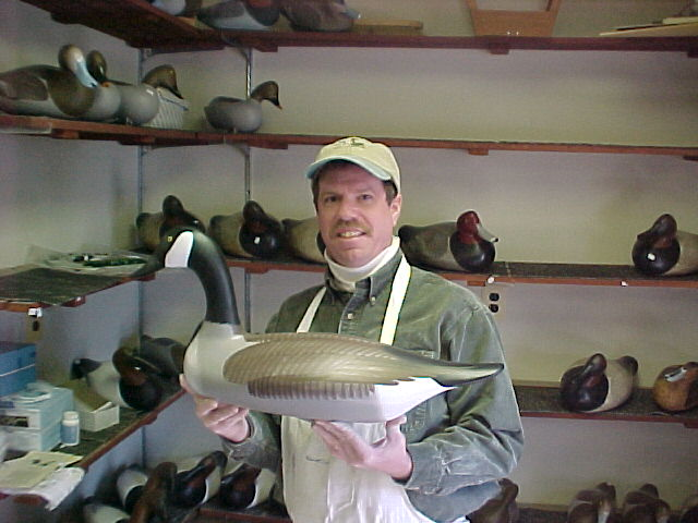 Joey Jobes in his shop in Havre de Grace, MD holding a Canada Goose decoy